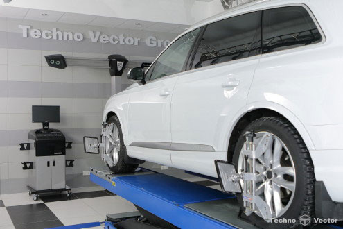 wheel alignment machine on a lift